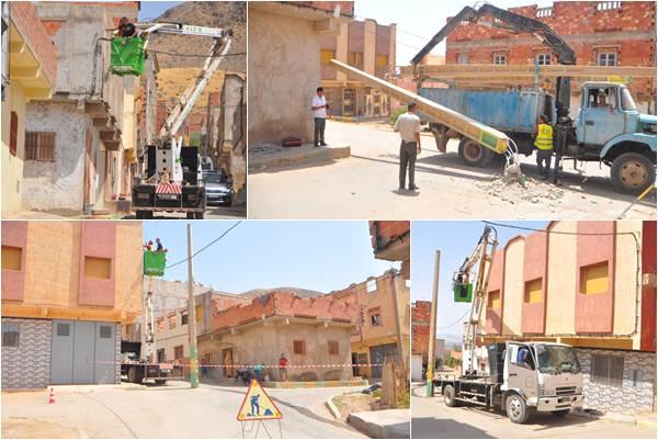 عملية إزالة الأعمدة الكهربائية من وسط شوارع حي بوزوف
